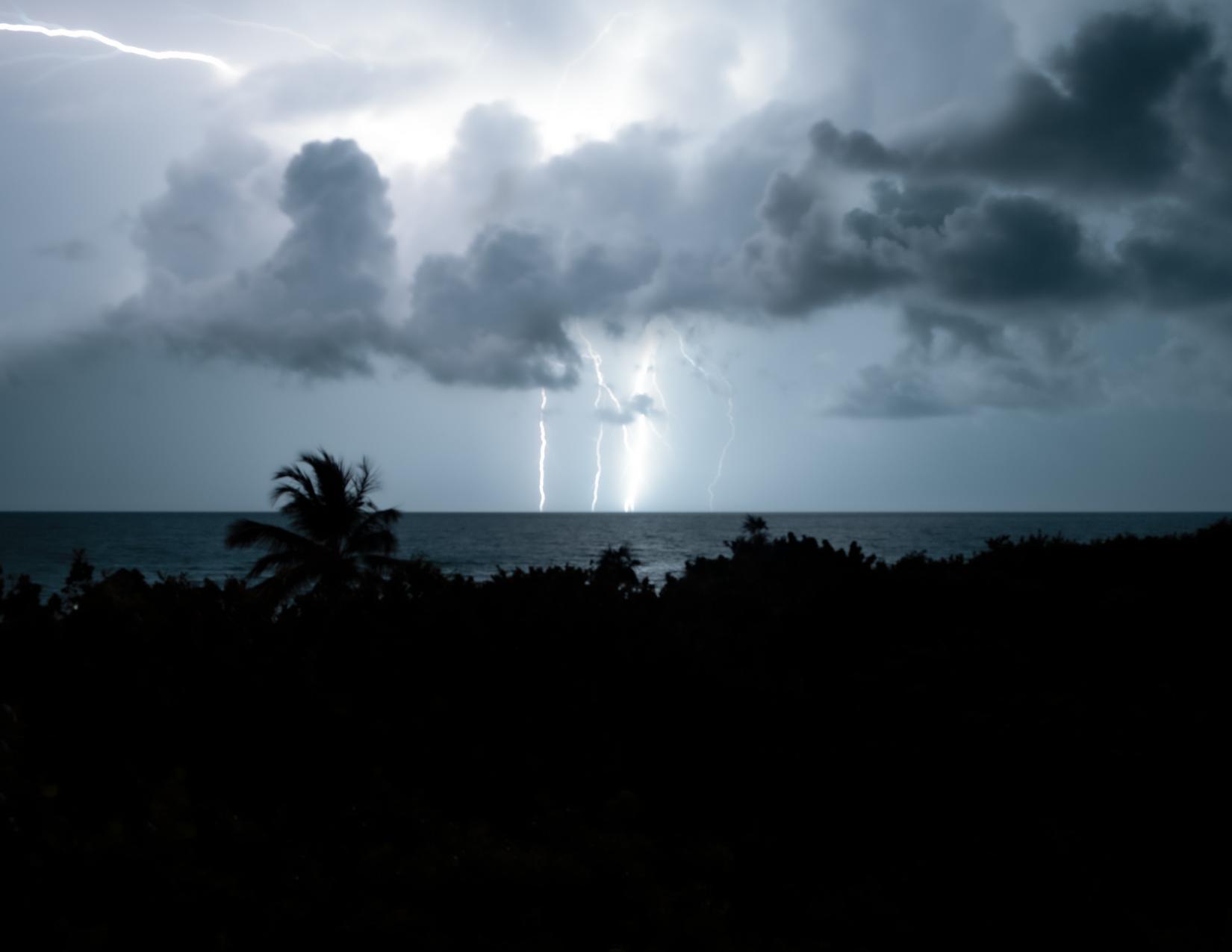 lighting striking ocean